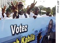 Supporters of President Joseph Kabila chant slogans in Kinshasa, 26 October 2006