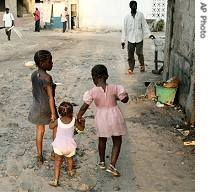 Children walk down a street in the city of Kinshasa, Congo, 31 Oct 2006